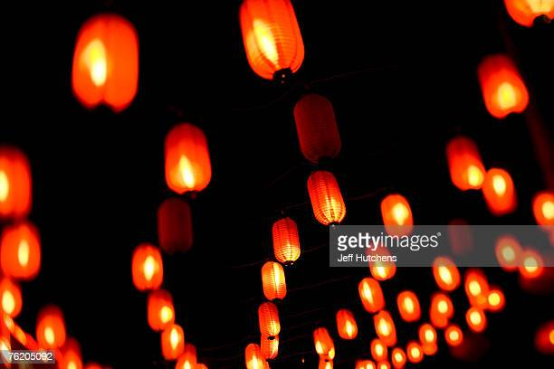 Red lanterns sit outside a Beijing restaurant on June 30 2006 in Beijing China China continues to open both socially and economically with the 2008...