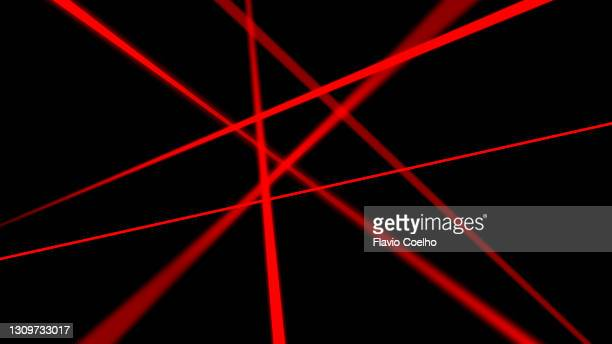 red laser beams on black background - strip stock pictures, royalty-free photos & images