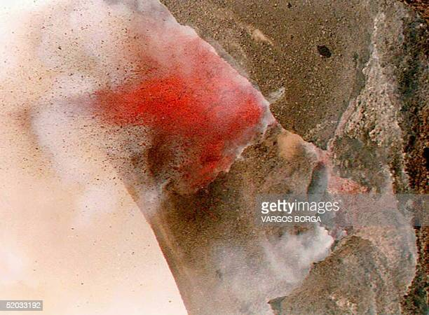 Red lava streams 14 April from the crater of the Fogo Island volcano which erupted 01 April Hundreds of local residents have been evacuated as the...