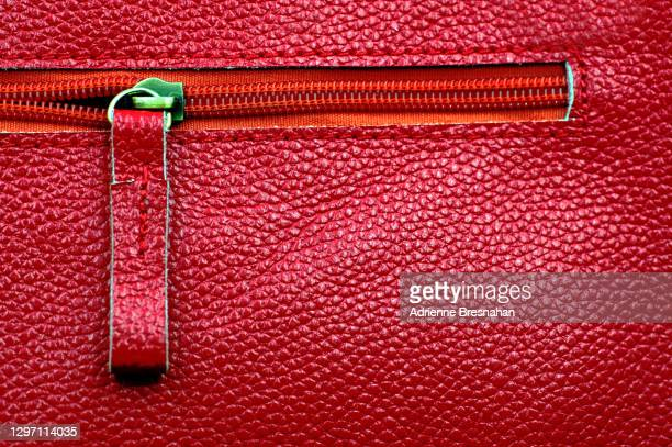 red leather and zipper - leather stock pictures, royalty-free photos & images