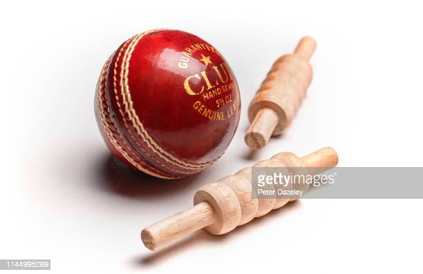 red leather cricket ball and bails - sport of cricket stock pictures, royalty-free photos & images