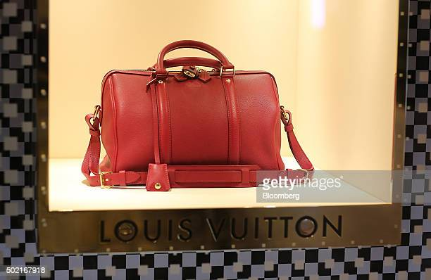9e885d107ff9 A red leather handbag sits in the window display of an LVMH Moet Hennessy  Louis Vuitton