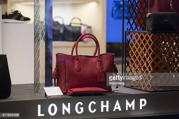 A red leather handbag sits on display inside a Longchamp SAS luxury goods store in BadenBaden Germany on Monday Oct 24 2016 The world's luxurygoods...