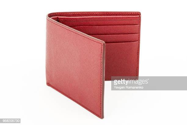 red leather wallet isolated on white background - wallet stock pictures, royalty-free photos & images