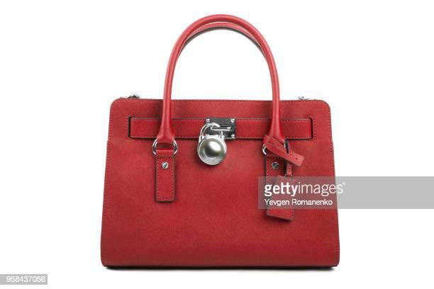red leather women's handbag on white background - sac à main rouge photos et images de collection