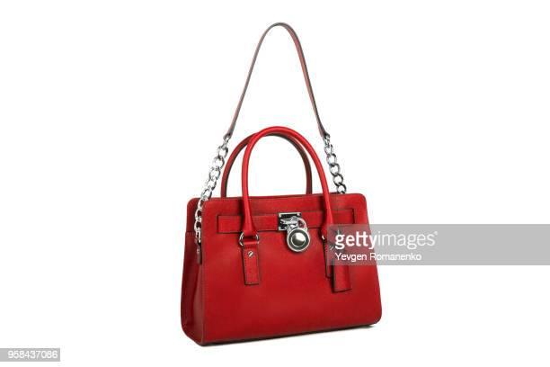 red leather women's handbag on white background - sac à main en cuir photos et images de collection