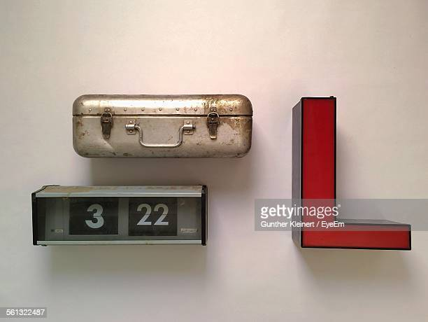Red Letter L And Retro Briefcase Mounted On Wall