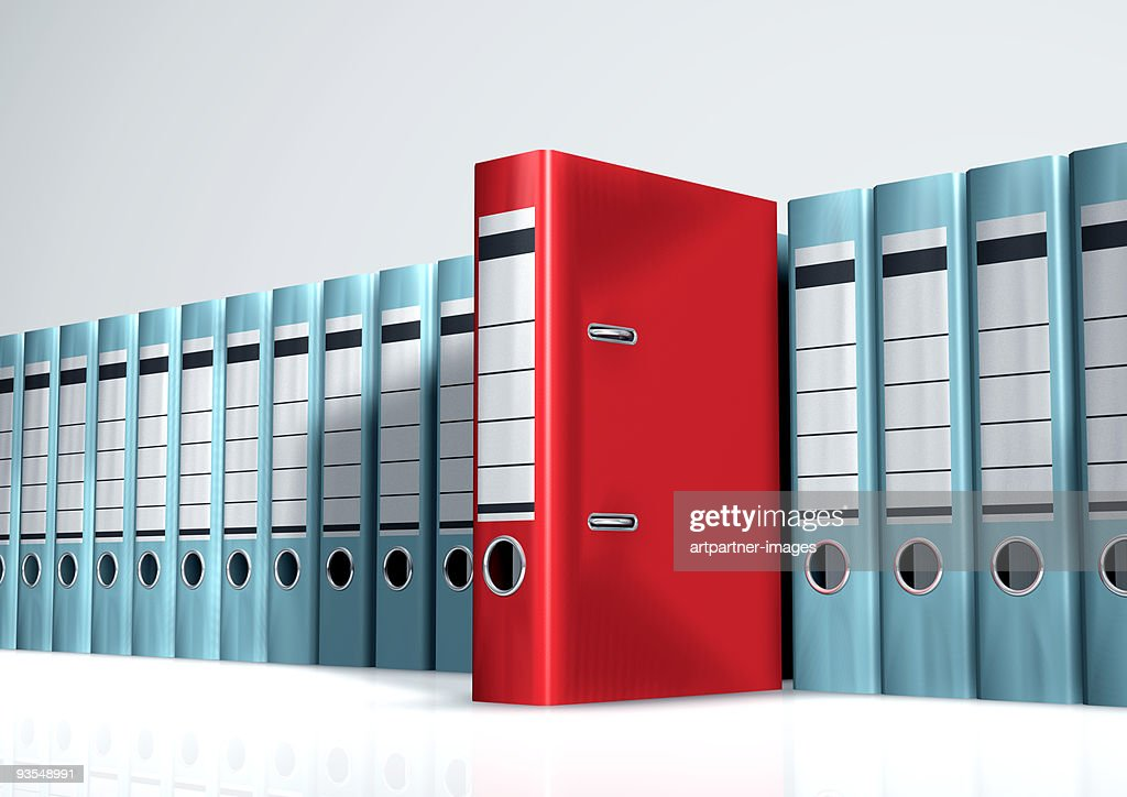 Red Lever Arch File in a Row of Grey Files : Photo
