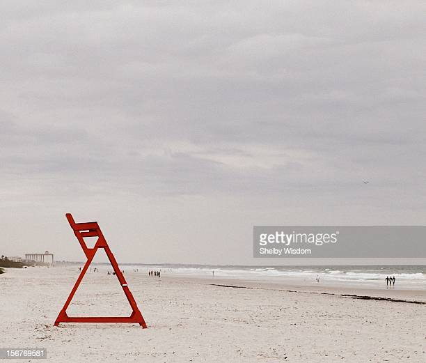 Red life guard chair on beach