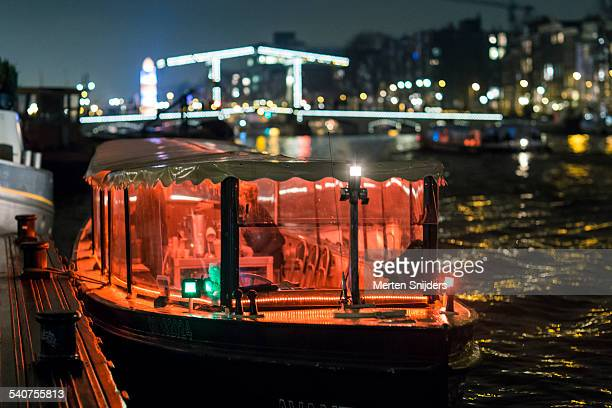 Red Light bar boat docked along Amstel River