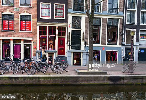 red light district in amsterdam, netherlands - red light district stock photos and pictures