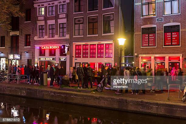 red light district in amsterdam - red light district stock photos and pictures