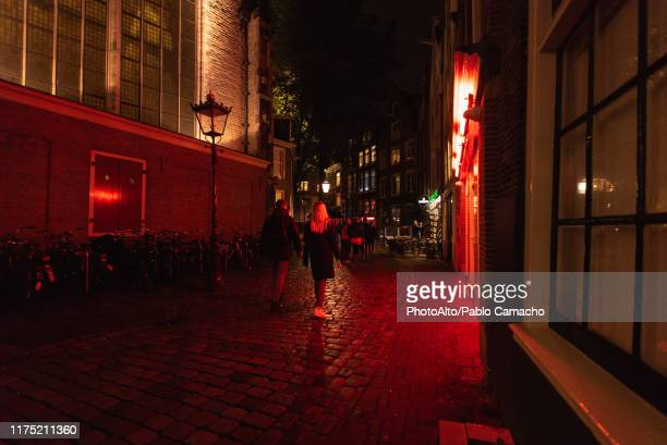 red light district of amsterdam - red light district stock pictures, royalty-free photos & images