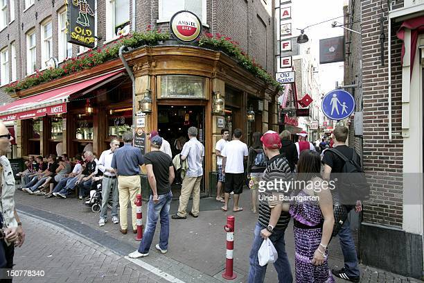 NETHERLANDS AMSTERDAM Red light district with tourists and bars in Amsterdam