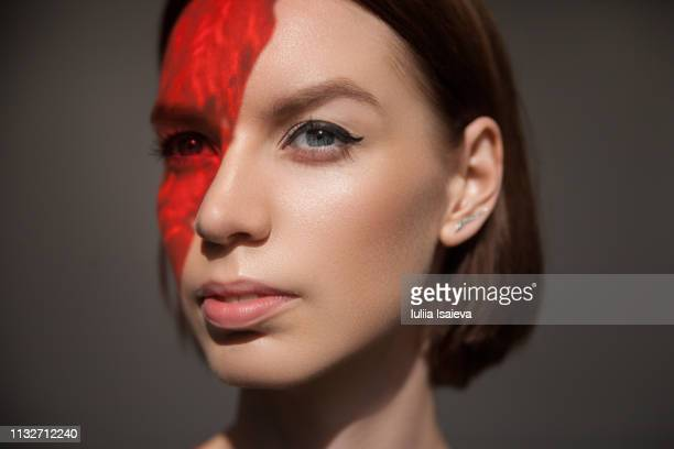 red light on face of young model - vogue stock pictures, royalty-free photos & images