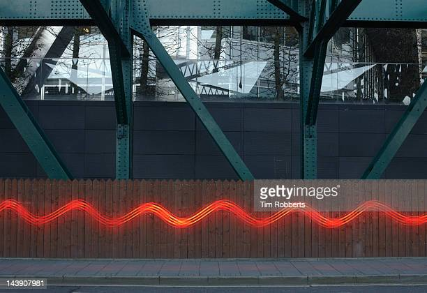 Red light trail in urban environment.