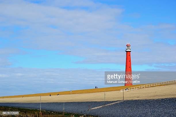 Red Lighthouse Against Sky