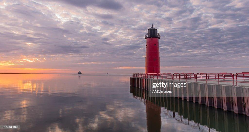 Red lighthouse on Lake Michigan at Sunrise : Stock Photo