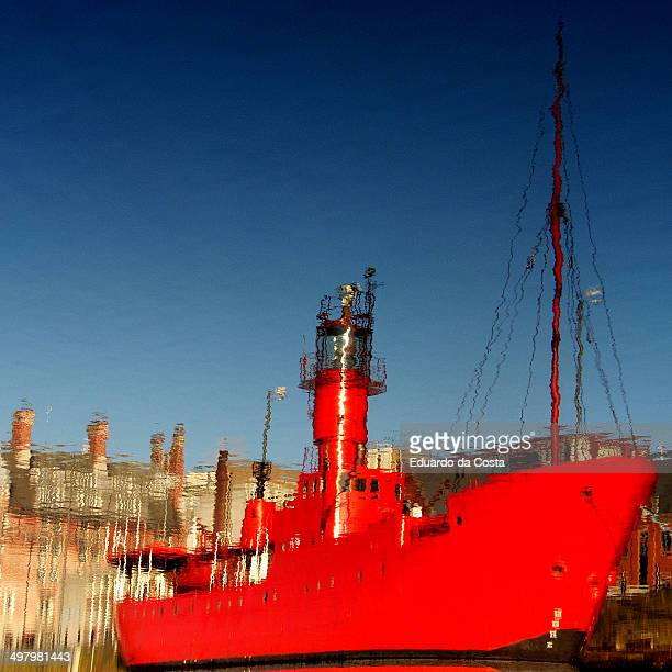 Red lighthouse ship at the harbor.