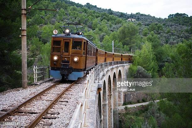 Red Lightning Palma to Soller train crosses bridge.