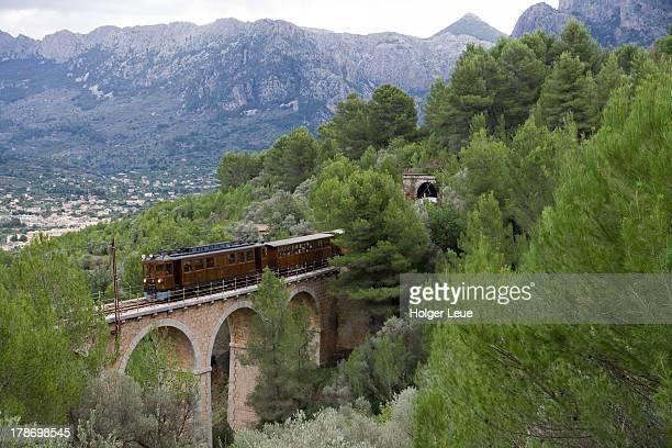 Red Lightning Palma to Soller train crosses bridge