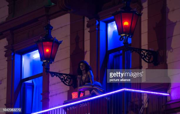 Red lights can be seen at a brothel during the 'Bahnhofsviertelnacht' in Frankfurt/Main Germany 8 September 2016 Several tens of thousands of...