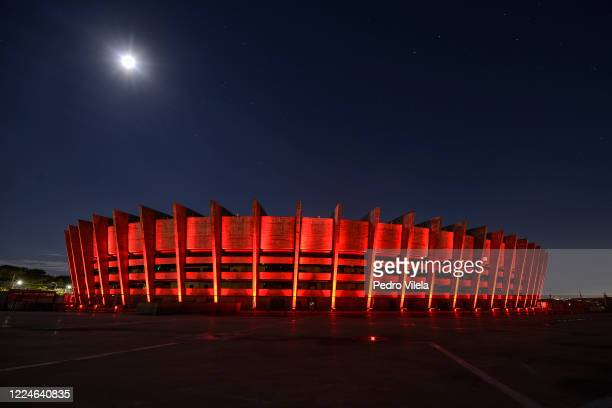 """Red lights illuminate the Mineirao stadium on July 3, 2020 in Belo Horizonte, Brazil. Entertainment companies created the """"Night of Light"""" day, and..."""