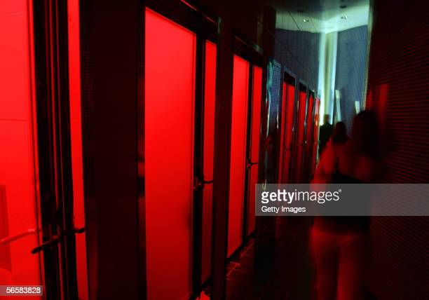 Red lights illuminate the unisex rest room area of the Seamless Adult Ultra Lounge during the club's grand opening early December 18 2005 in Las...
