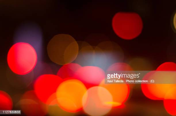 red lights in bokeh - red light stock pictures, royalty-free photos & images