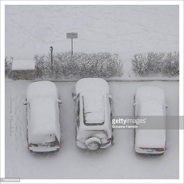 Red lights on snow covered cars