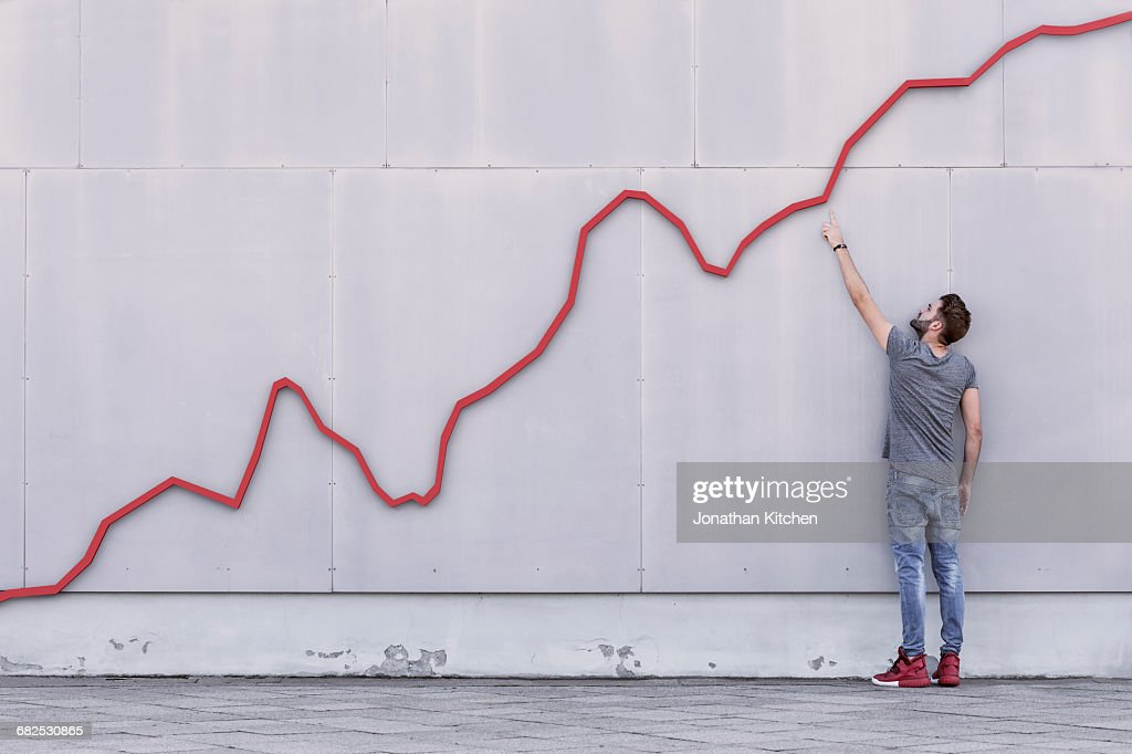 Red line graph with man : Stock-Foto