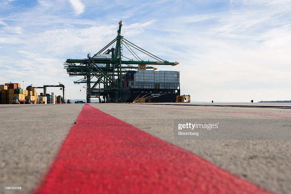 Red lines mark access routes towards the dockside gantry cranes operated by PSA Sines and the visiting cargo vessel MSC Renee at the open deep-water Port of Sines in Sines, Portugal, on Tuesday, Dec. 11, 2012. The Portuguese government is ready to implement additional measures in 2013 if there are slippages in meeting budget targets, the European Commission said. Photographer: Mario Proenca/Bloomberg via Getty Images