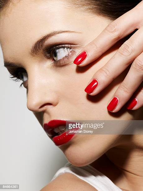red lips and nails profile