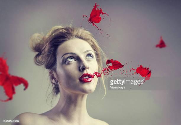 Rote Lippenstift Schmetterling