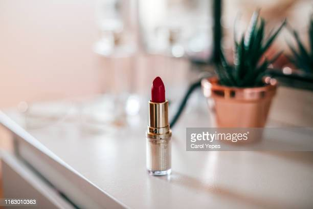 red lipstick on  dressing table - lip balm stock pictures, royalty-free photos & images