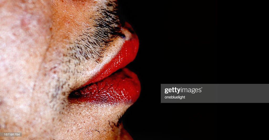Red lipstick on man's lips : Stock Photo