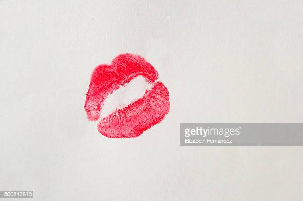 Red lipstick stain on white background