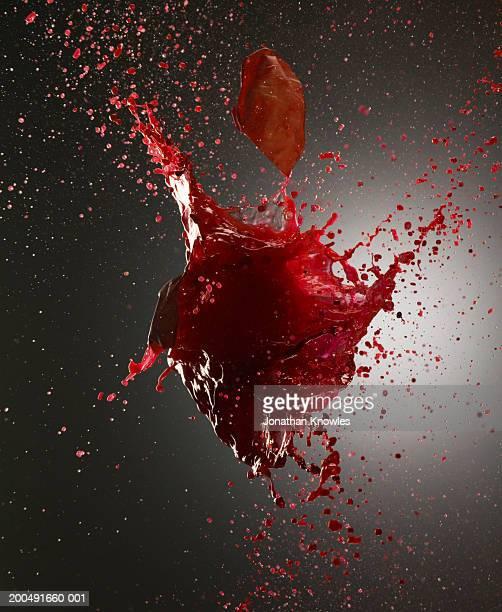 Red liquid exploding, close-up