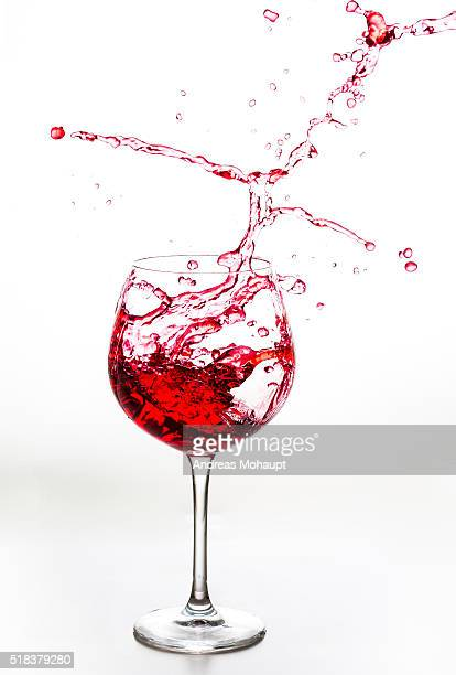 Red Liquid splash out of a glass