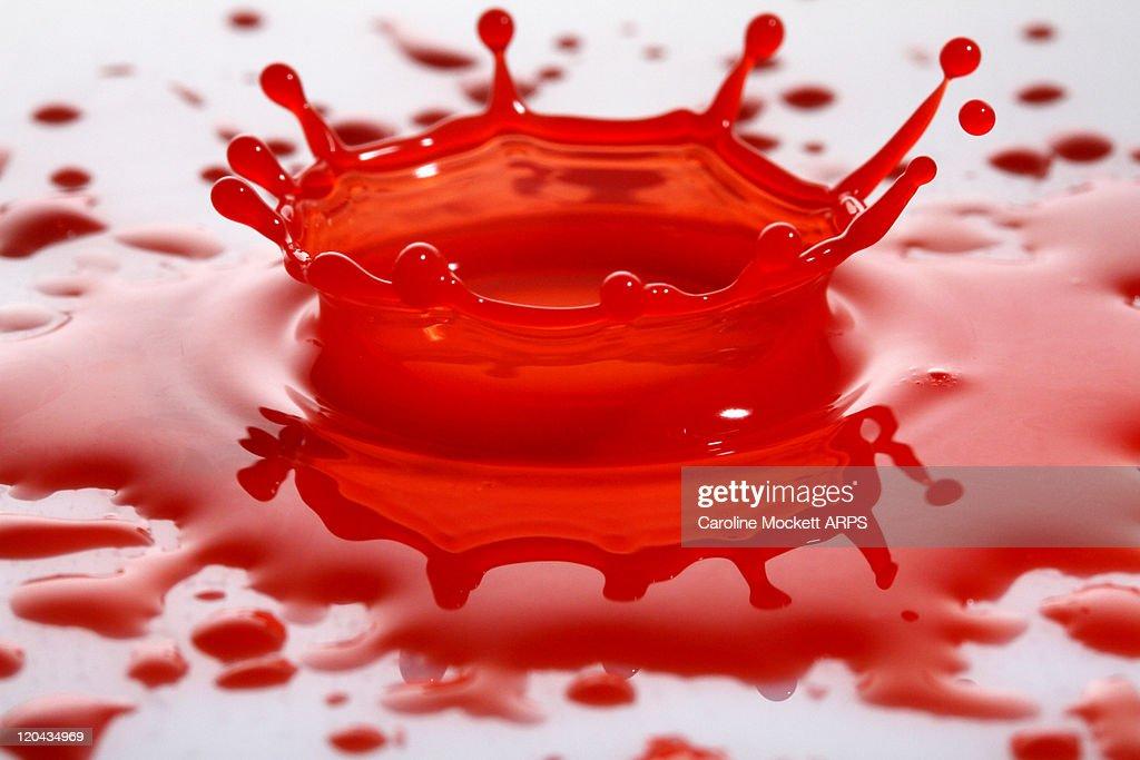 Red liquid splash : Stock Photo