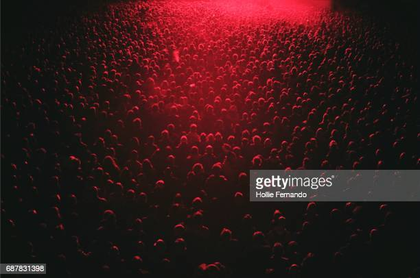 red lit festival crowd - crowd stock pictures, royalty-free photos & images