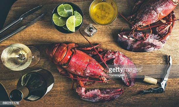 red lobster served and ready to eat - chardonnay grape stock photos and pictures