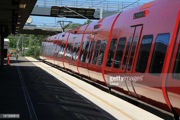 red local train on taastrup station in denmark - danish culture stock pictures, royalty-free photos & images