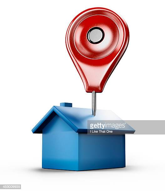 Red location pin stuck into a blue house icon