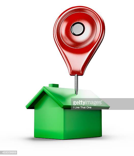 Red location pin stuck into a green house icon