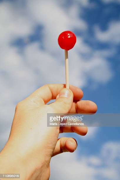 Red lollipop and blue sky