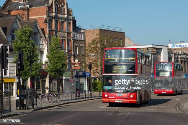 Red London buses in the Enfield town. England.