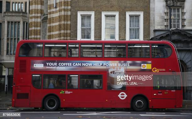A red London doubledecker bus is seen in Westminster central London on November 20 2017 London's caffeine habit could soon provide an ecofriendly...
