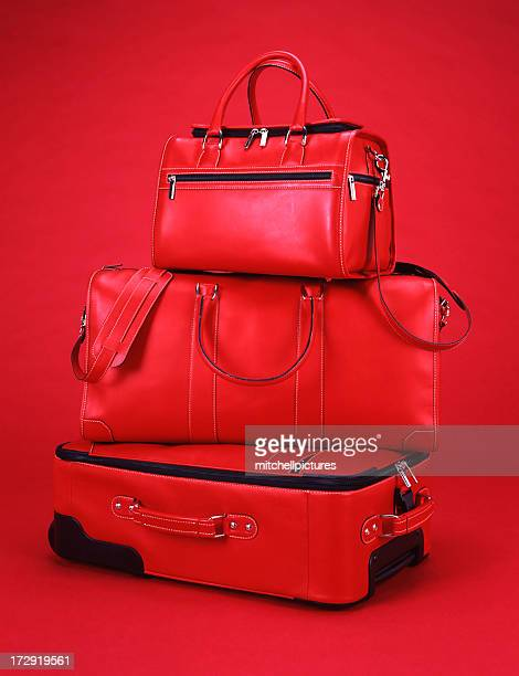 red luggage with a red background - bag stock pictures, royalty-free photos & images