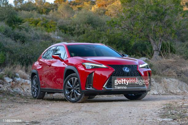 red luxury suv lexus ux 250h on the road - toyota motor co stock pictures, royalty-free photos & images